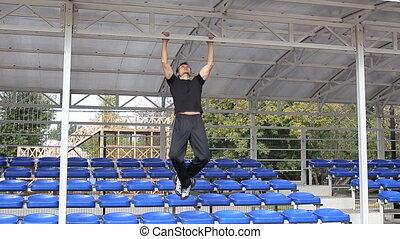 athlete pulls on the university stadium - athlete pulls on...