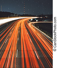 Car light streaks - tail light streaks at night on a super...