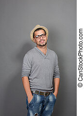Fashionable hipster man looking at the camera in studio -...