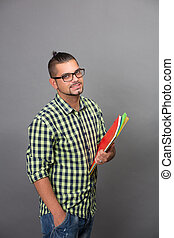 Fashionable hipster man holding documents in studio -...