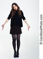 Beautiful girl shrugging shoulders - Full length portrait of...