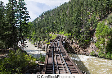 Railroad tracks through the mountains between Durango and...