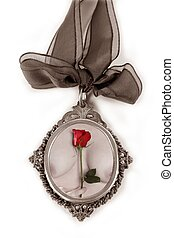 Cameo silver locket with valentines red rose on nude woman...