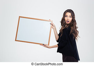 Attractive young girl showing blank board
