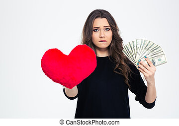 Girl choosing between love or money - Concept image of a...
