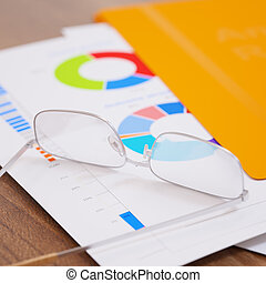 Business report with graphs and figures close-up