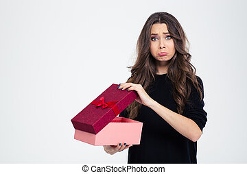 Sad woman standing with opened gift box - Portrait of a sad...
