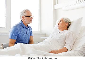 senior couple meeting at hospital ward - medicine, age,...