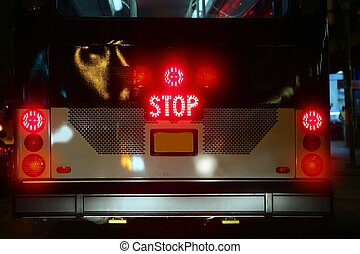 Bus stop signal glowing  red with traffic lights