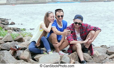 Threesome gay friends make selfieie riverside - Young...