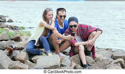 Threesome gay friends make selfieie - Young friends have fun...