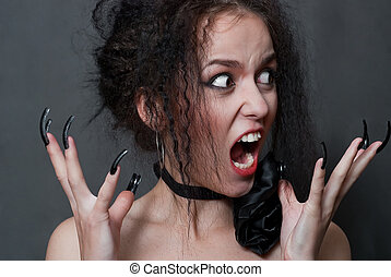 witch with black nails - beauty young witch with black nails...