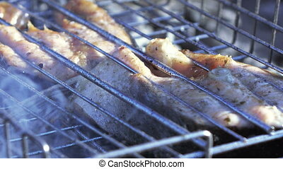 Cooking fish on grill - On iron grill prepared fatty fish