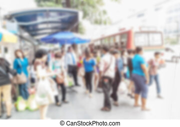 abstract image of people in town in the rush hour of a...