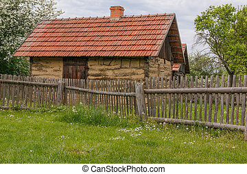 Old village and its rural house with fence