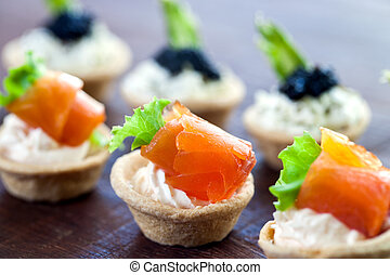 Multiple mini seafood pastry tartlets. - Macro close up of...