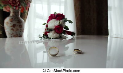 Rotating wedding rings near bouquet on the piano - Beautiful...