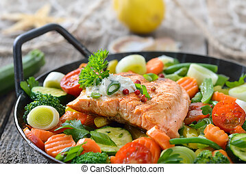 Salmon fillet on vegetables
