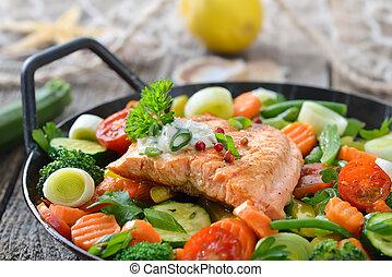 Salmon fillet on vegetables