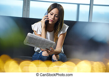 Woman Looking For Job Reading Announcement On Newspaper