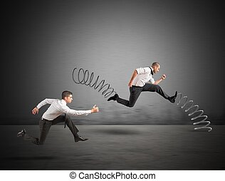 Irregular competition - Businessman with spring runs against...