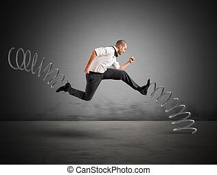 Fast businessman - Businessman running fast with the big...