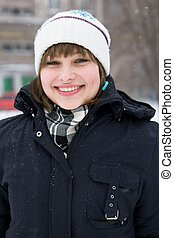 Smiling young girl in winter day - Portrait of a smiling...
