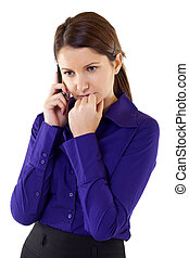 A businesswoman worries over the phone - A businesswoman...