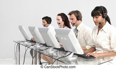 Business people working in a call centre against a white...