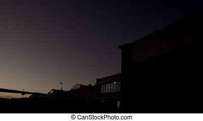 Low angle dusk/night shot of parked private jet (Cessna...