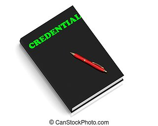 CREDENTIAL- inscription of green letters on black book on...