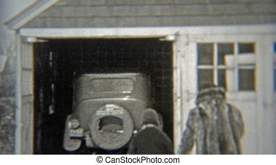 1938: During winter, family getting in car - Original...