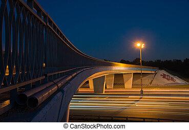 bridge over highway in the evening