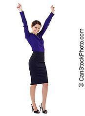 woman cheering with arms in the air - a young business woman...