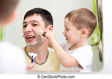 Father and child son shaving together at home bathroom -...
