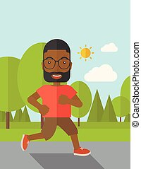 Jogger - An african-american hipster man in glasses jogging...