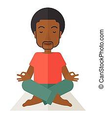 Yoga man - An african-american man meditating in lotus pose...