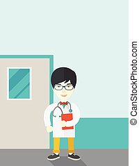 Doctor - A happy asian doctor in glasses standing and...