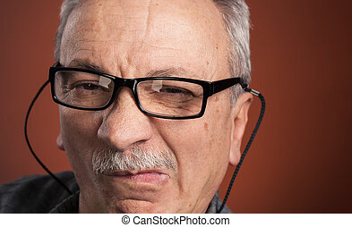 man in glasses with a grimace of pain - Close-up portrait of...