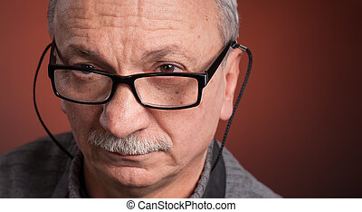 An elderly man with glasses - Close up portrait of an...