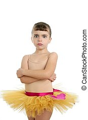 Ballerina little girl portrait posing at studio white...