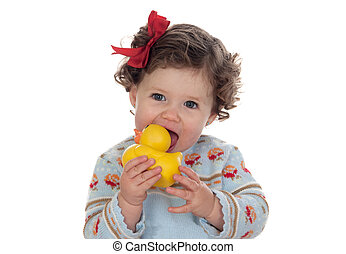 Beautiful blue-eyed baby sucking a rubber duck isolated on...