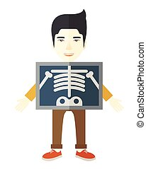 X-rays. - An asian patient with x-ray screen showing his...
