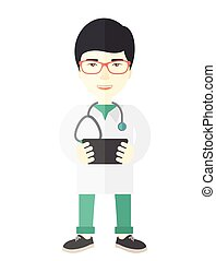Doctor - A happy asian doctor in glasses holding a...