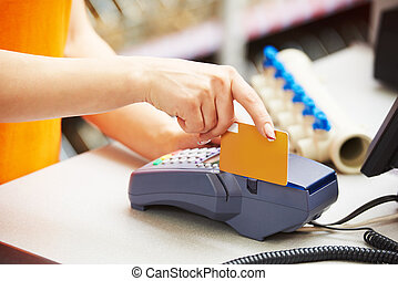using credit card payment terminal in shop - sale assistant...