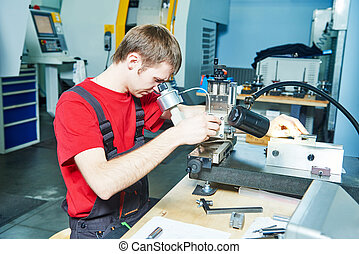 worker checking tool with optical device - metalwork worker...