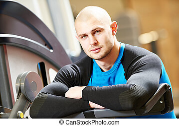 male fitness trainer at gym - Portrait of a male fitness...