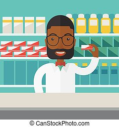 Pharmacist - An african-american pharmacist at the counter...