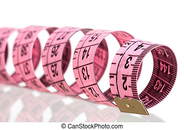 Pink tape measure with reflection on the floor isolated on...