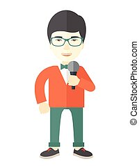 Reporter - An asian reporter wearing green glasses speaking...
